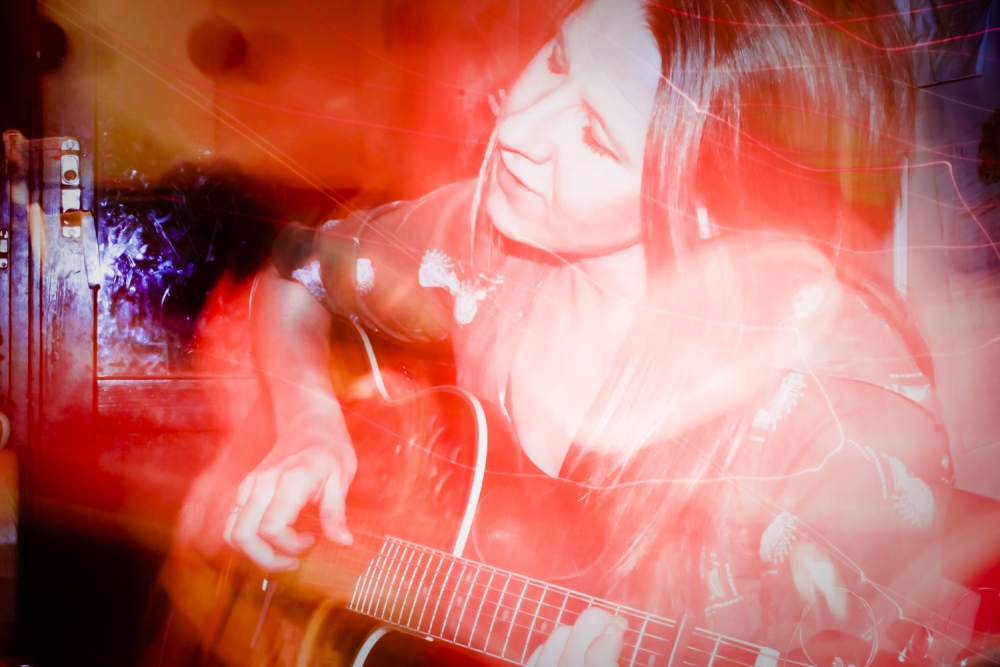 Sofia plays the guitar
